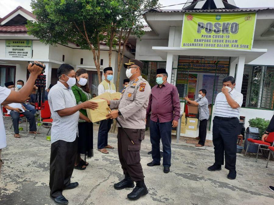Kapolres Siak dan Bupati Beri Bantuan Masker, Obat Obatan dan Sembako